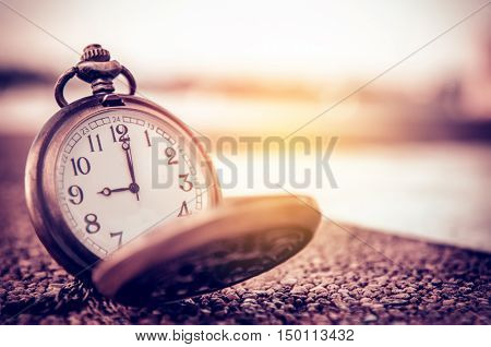 vintage pocket watch time concept at 9 o'clock