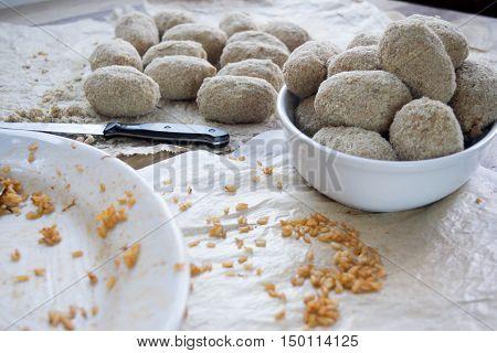 preparing Italian rice balls called suppli or arancine