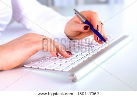 A young businesswoman working on a laptop .