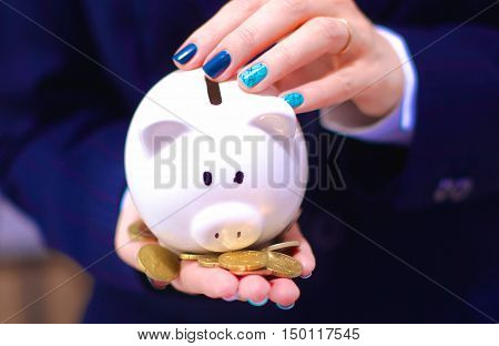 Young beautiful woman  with piggy bank, isolated on white background.