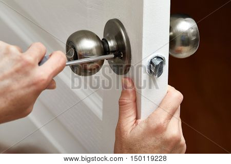 Door knob installation.