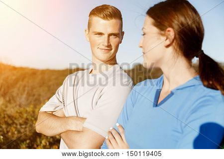 Young couple on beach in sportwear