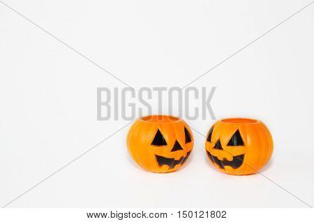 Two Orange Jack-o-lantern Bucket Pumpkins In White Isolated Background