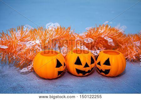 Orange Jack-o-lantern Bucket Pumpkins And Halloween Themed Decors On Grungy Background