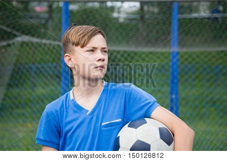 Child with a ball playing football