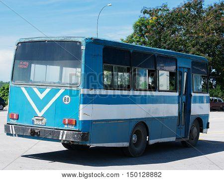 Varadero, Cuba - September 11, 2016:  blue American Classic bus Dirves in Varadero City, Cuba