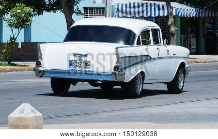 Varadero, Cuba - September 11, 2016:  white American Classic Car Dirves in Varadero City, Cuba