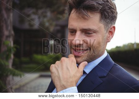 Close-up of thoughtful businessman outside office