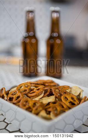 Bowl of snacks on counter at bar