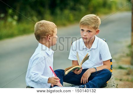 Two boys are talking together to play