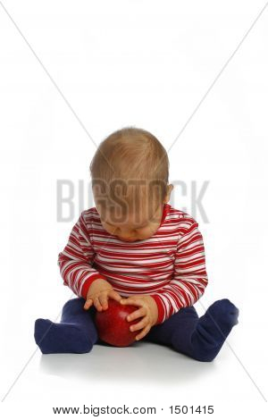 Small Child With An Apple