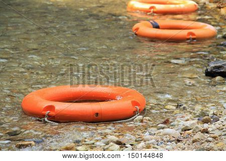 life preserver float in the river. Safety and lifesaver concept