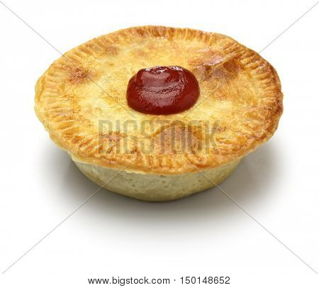 homemade aussie meat pie on white background