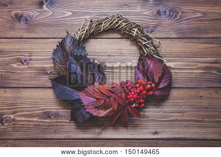 Autumn Wreath On Wooden Background