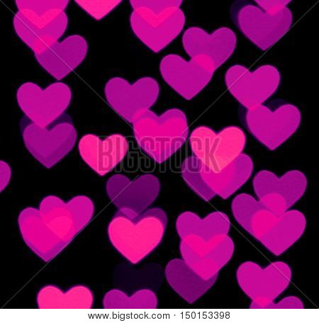 heart bokeh background, photo blurry objects, pink on black