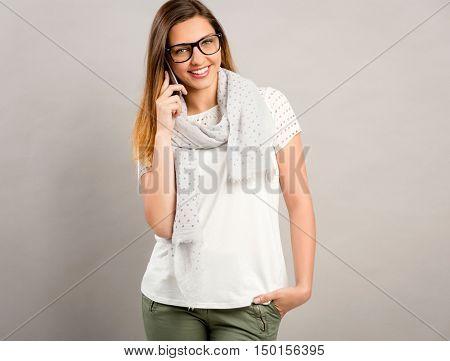 Beautiful happy woman talking at phone