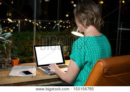 Businesswoman working on laptop in the office