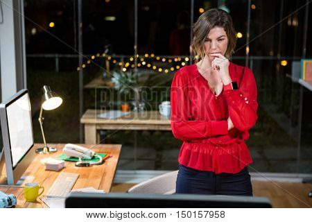 Businesswoman looking at computer screen in the office