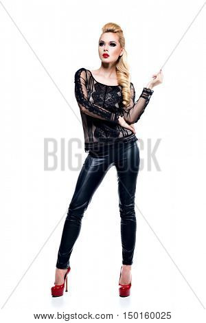 Full portrait of the beautiful young sexy woman with long blonde hair posing at studio isolated on white.