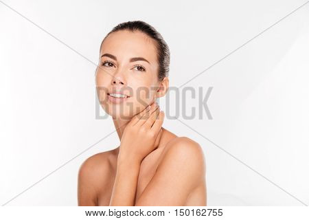 Beauty portrait of a lovely woman with fresh skin standing isolated on a white background