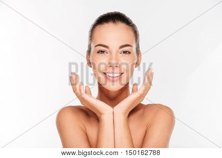 Beauty portrait of a young woman with fresh skin isolated on a white background