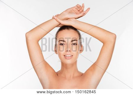 Beauty portrait of a cute woman with skin care looking at camera isolated on a white background