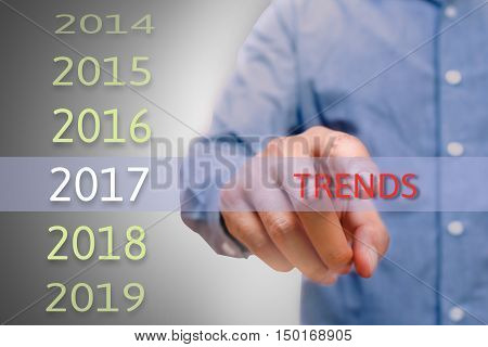 bussinessman hand pointing trends text for 2017. targets concept