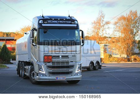 SALO, FINLAND - OCTOBER 1, 2016: New white Volvo FH fuel tank truck in city of Salo. The ADR code 33-1203 signifies gasoline.