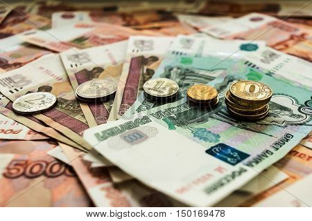 A lot of money rubles dollars euros and coins of gold and silver. Money is a symbol of government business good luck.
