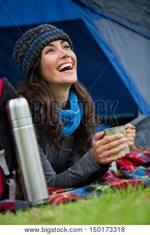 Laughing woman in a tent in the countryside