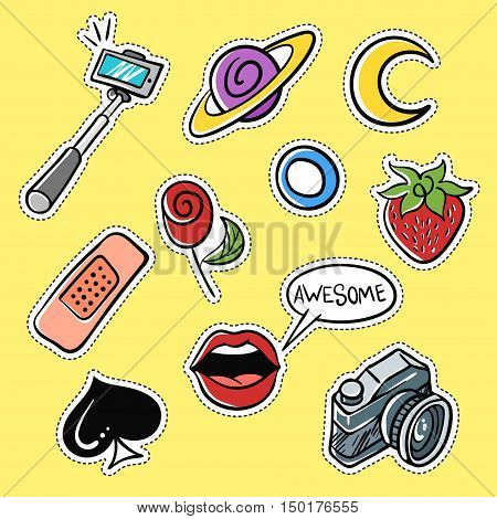 Vector set of fashionable patches: selfie stick, lips, strawberry, moon . Modern doodle pop art sketch pins and badges. Hand drawn cute and funny fashion stickers kit. Isolated on yellow background.