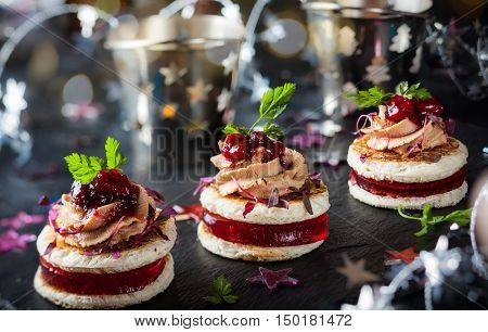 Festive appetizer with foie gras, cranberry chutney and jelly poster