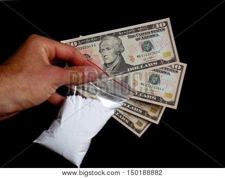 Men holding bag with cocaine drug powder and US money, dollar bills cash, men selling drugs junkie