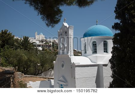 Traditional orthodox white church with blue dome in the Greek island of Sifnos in Greece