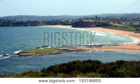 Mona Vale rock pool in a distant panoramic view from elevated lookout during low tide surfing waves and sandy beach australia sydney northern beaches poster