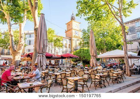 Salon-de-Provence, France - June 17, 2016: View on the central square with cafes, bars and old city gate or clock tower in Salon-de-Provence