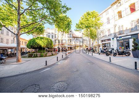 Salon-de-Provence, France - June 17, 2016: View on the central square with cafes, bars and famous old mossy fontain in Salon-de-Provence