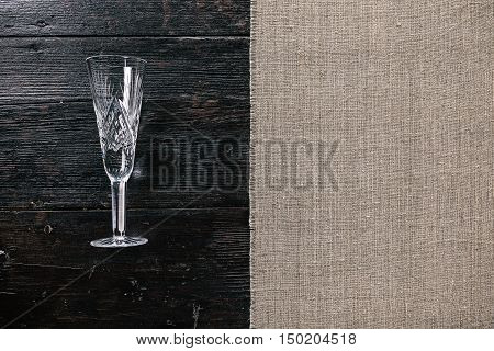 Still life with empty wineglass on the half covered table. Flat lay