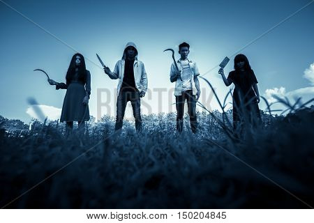Group of stranger people with weapon to prank on halloween,Scary background for book cover