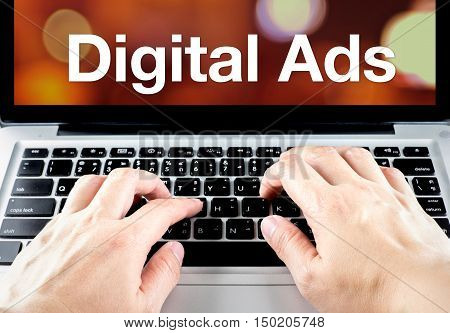 Digital Ads Word On Laptop Screen With Hand Type On Keyboard, Digital Advertising Concept