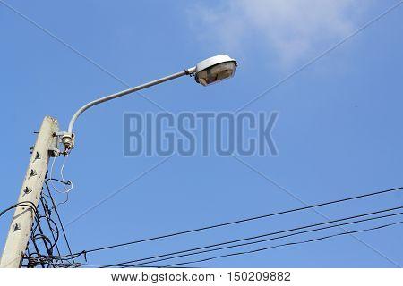 Lighting poles on the blue sky background.