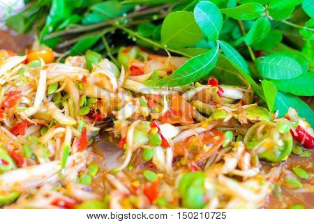 Schinus terebinthifolius Brazilian Pepper-tree with papaya salad.Thai favorite food