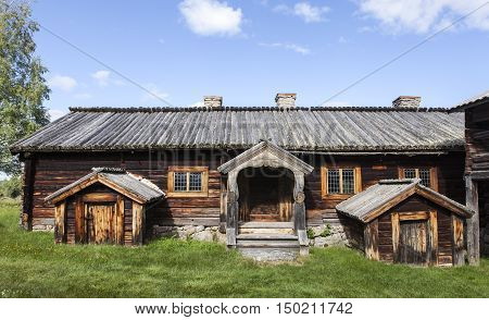 HARJEDALEN, SWEDEN ON JULY 07. View of an outdoor museum, wooden homestead on July 07, 2016 in Harjedalen, Sweden. Rustic buildings in log, timber construction from 17th. Editorial use.