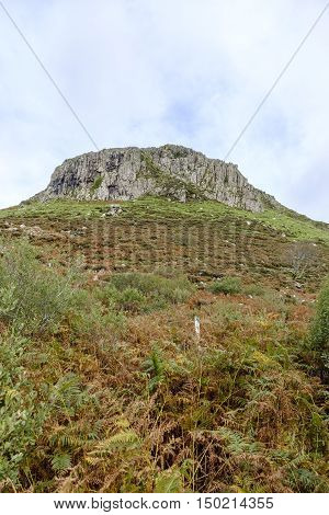Looking up towards the rugged peak of Cnoc Glas Heilla at Portnalong near Carbost in Isle of Skye Scotland
