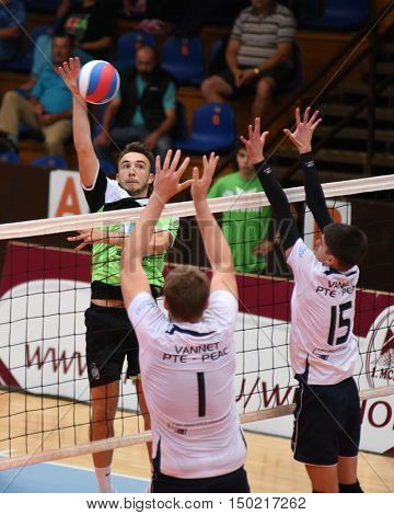 KAPOSVAR, HUNGARY - SEPTEMBER 30: Gabor Bogoly (with ball) in action at a Hungarian National Championship volleyball game Kaposvar (green) vs. PEAC (white), September 30, 2016 in Kaposvar, Hungary.