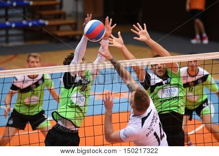 KAPOSVAR, HUNGARY - SEPTEMBER 30: Cameron Keen (green 10) in action at a Hungarian National Championship volleyball game Kaposvar (green) vs. PEAC (white), September 30, 2016 in Kaposvar, Hungary.