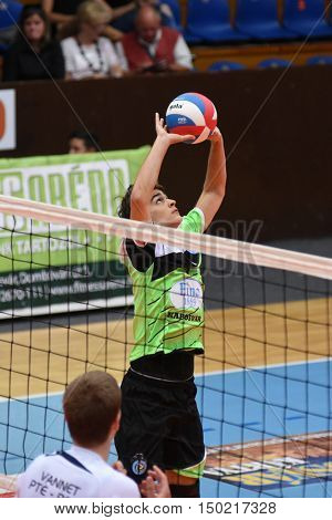KAPOSVAR, HUNGARY - SEPTEMBER 30: Bence Szabo (with ball) in action at a Hungarian National Championship volleyball game Kaposvar (green) vs. PEAC (white), September 30, 2016 in Kaposvar, Hungary.