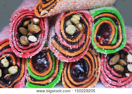 Different colorful tasty Turkish sweet as background