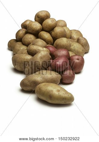 A pile of various types of potatoes isolated on a white background