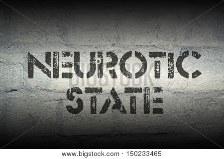 neurotic state stencil print on the grunge white brick wall
